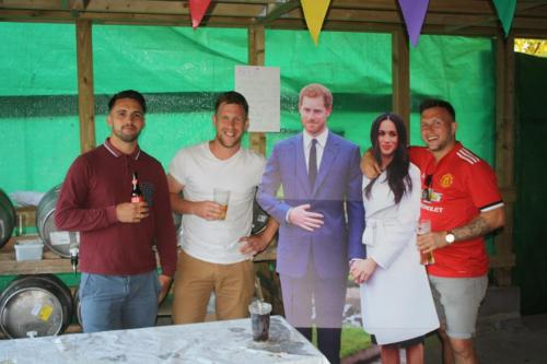 Lyme Regis Football Club members with 'Harry and Meghan'