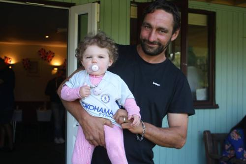 Lyme footballer Pete Peacock with one of his twin daughters supporting Chelsea in the FA Cup Final