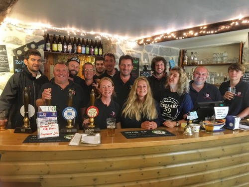 Lyme Regis lifeboat crew pictured at Cellar 59 which donated profits from one of its craft beers to the RNLI