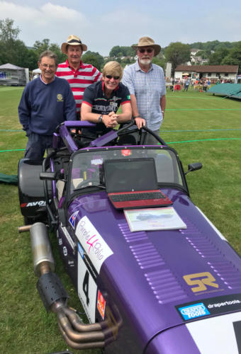 Members of the Rotary Club of Lyme Regis with their 'Purple4Polio' race car