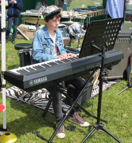 Young musician Frankie Adlam from B Sharp entertains on the keyboard