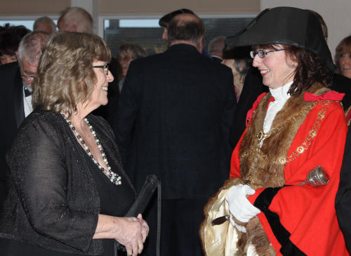 Town and district councillor Cheryl Reynolds is welcomed by Councillor Ellis