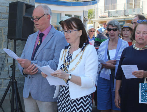 The Mayor of Lyme Regis, Councillor Michaela Ellis, and her husband Alan join in with hymns
