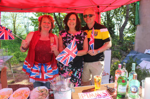 Lyme Regis Football Club chairman Howard Larcombe with his wife Heather (centre), who helped to organise the celebrations, and volunteer Lin Paterson on the Pimm's tent