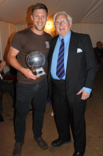 RETIRED referee Bob Hall presents the Top Scorer award to Steve Batey, who was head chef on the night