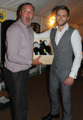 Reserves captain Alex Rowe presents a gift to manager Gerard Hitchcock