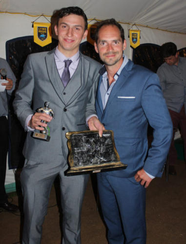 INTERIM First Team manager Mark Bailey (right) presents his award to Kingsley Wellman
