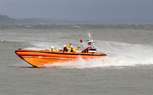 The lifeboat crew welcome visitors with a display