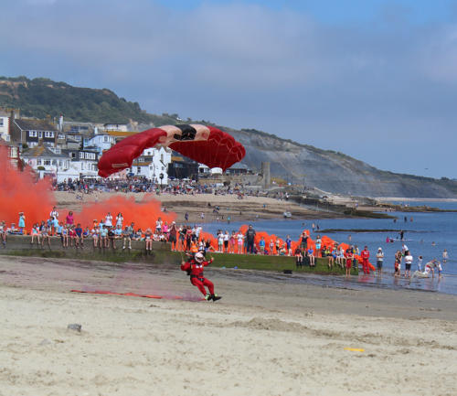 The Red Devils drop onto Lyme Regis beach
