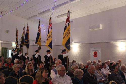The standard bearers enter for the service of remembrance