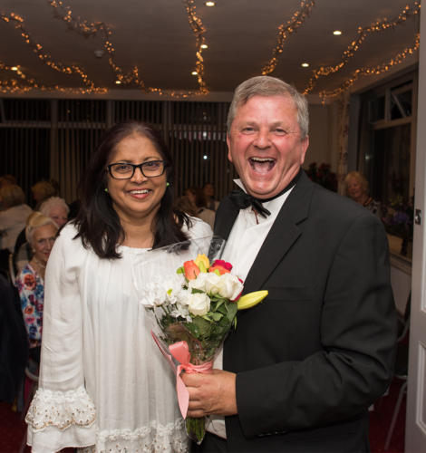 Graham Paterson presents a bouquet to Belinda Iyavoo