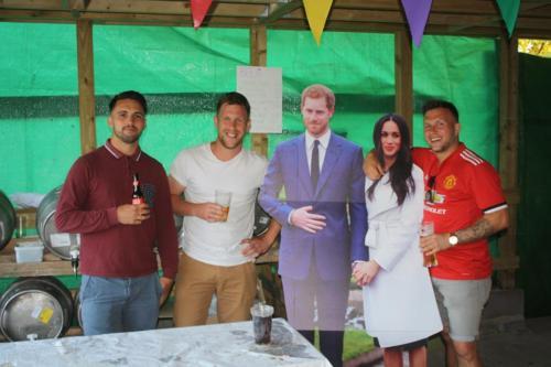 Lyme Regis Football Club members with 'Harry and Meghan'