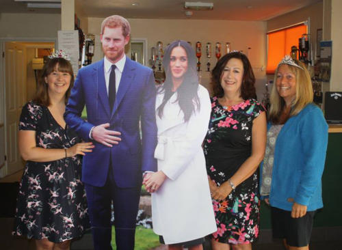 Event organisers Francesca Evans, Heather Larcombe and Nicky Levan pictured with the royal couple