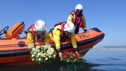 The lifeboat crew drop the wreaths at sea following the annual ceremony