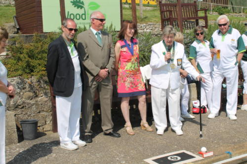 Lyme Regis Bowls Club president Pat Cole welcomes the Mayor, Councillor Michaela Ellis and her husband Alan to the opening of the Charlie Mercer Green
