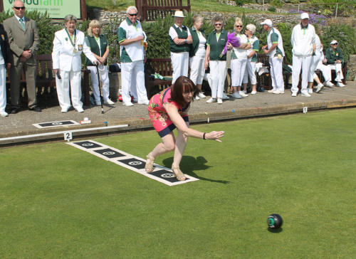 The mayor, Councillor Michaela Ellis, opens the 2018 bowls season by bowling the first wood, a task her great uncle Will Emmett did in 1939