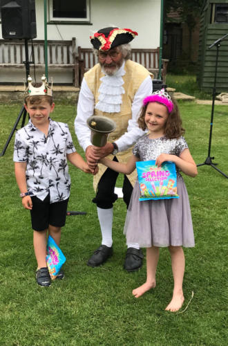 Town crier Alan Vian with Fete Prince and Princess, Seth Buller and Maisie White