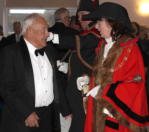 Former mayor Ken Dibben is greeted at the door