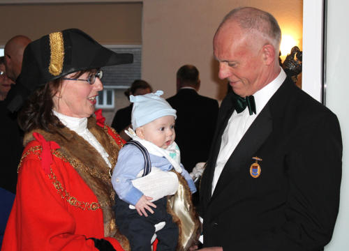 The mayor and her husband Alan with their new grandson Reuben - the youngest guest of the night