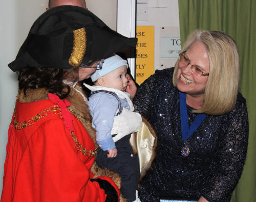 The mayor shows off her grandson to deputy mayoress Heather Miller
