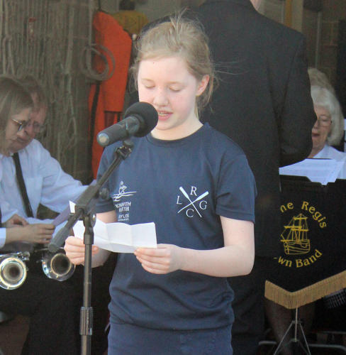 Local youngster Sophie Vernon reads a poem about the sea
