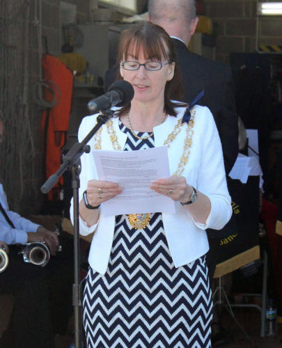 The mayor delivers a Bible reading during the service