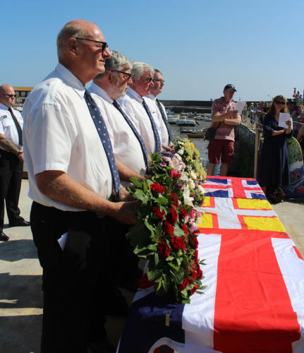 Volunteers from Lyme Regis lifeboat station pictured with the wreaths