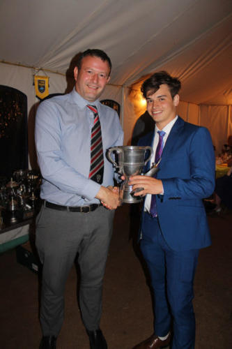 YOUNGPlayer of the Year Cody Bowditch receives his award from Richard White, secretary of the Perry Street League