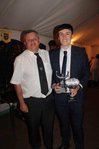 CLUB member Graham Paterson (left) presents Jake Bearpark with the Reserves Players' Player award
