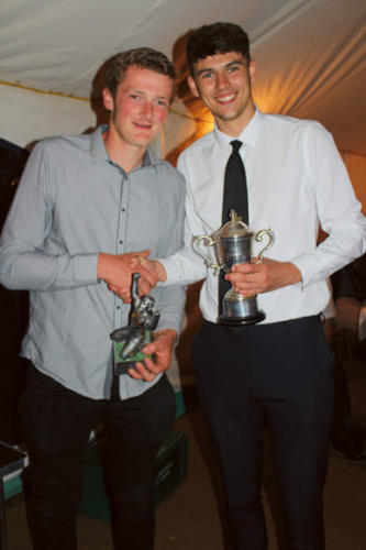 THE Robert Broom Trophy is presented by his grandson Bradley Rowe (right) to First Team Players' Player Fred Parsons