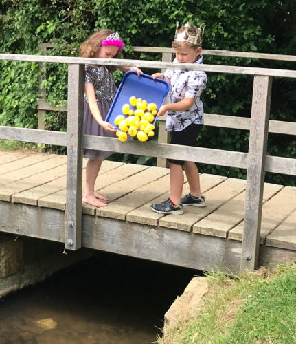 Fete Prince and Princess Seth Buller and Maisie White start the first duck race of the afternoon