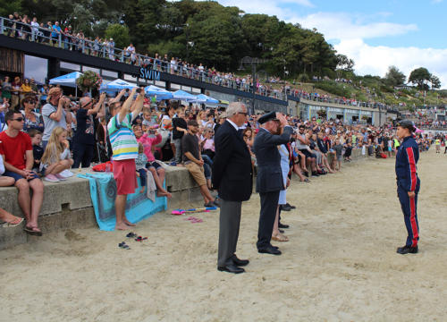 Captain Brian Lavender OBE (Retired) takes the salute after the Falcons land